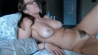 Milf squirts after fingering herself on webcam show